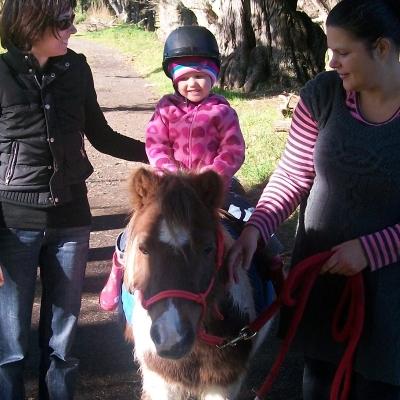 Zoe riding butterscotch