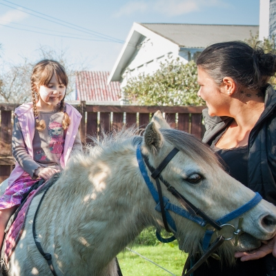 Zoe riding a pony