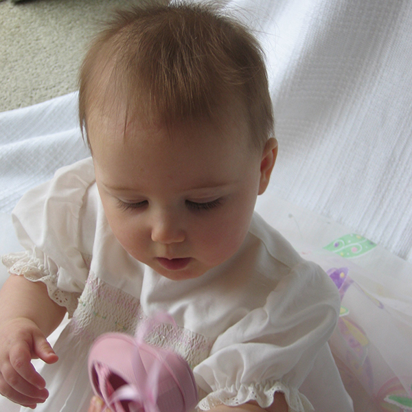 Baby girl with pink ballet shoe